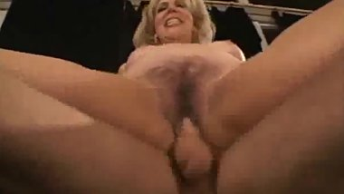 Blonde MILF rides on the couch