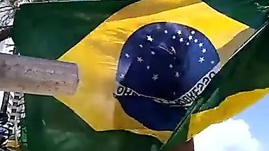 Crazy Dinha dancing with Brazil's flag