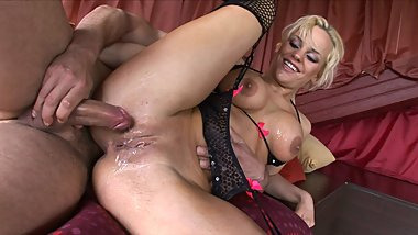 Hot blonde MILF sucks on two thick cocks at once in threesome