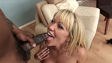 Dirty blonde blows big black cock on her couch
