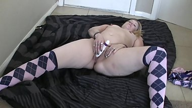 Fabulous blonde solo model in socks enjoys a solo masturbation session in bed
