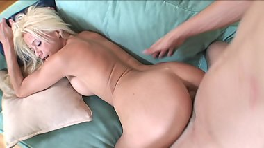 Blonde MILF slut loves fucking young cock on the sofa