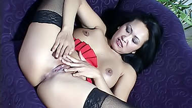 Asian playing with dildo alone