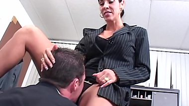 Busty brunette babe gets to fuck the big boss in his office