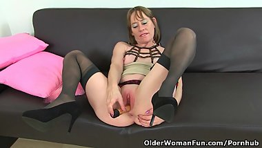 British milf Sexy P masturbates in stockings with suspenders