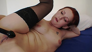 Redhead in stockings toying herself