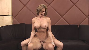 Brunette MILF with perky tits sits on dude's stiff pole