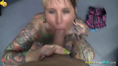 Big titted punk MILF sucks a cock