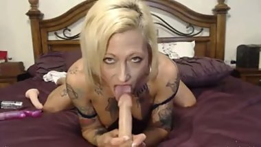 flexible MILF with big tits and tattoos
