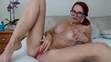 Redhead MILF with sexy body shows her slutty side