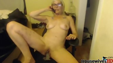 Blonde mature solo fucks in chair
