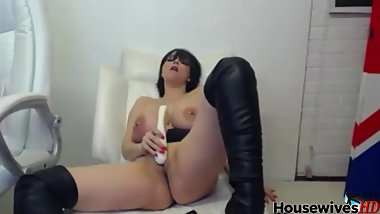 Huge tits MILF with high leather boots