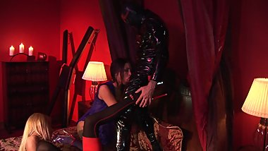 Horny blonde and brunette bend over to be banged by mystery man in latex suit