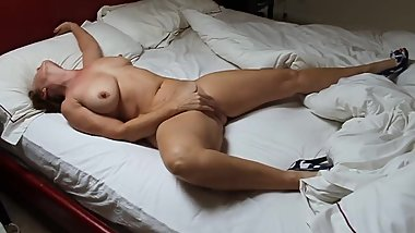 Mature wife fingering herself