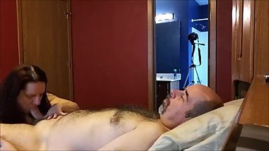 Husband Lays Back While Wife Sucks His Dick