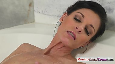 Masturbating stepmom caught in the bathtub