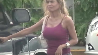 candid - blonde MILF with big tits in tight tanktop
