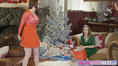 Lesbo MILF has a special gift for her gorgeous stepdaughter