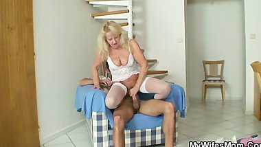Blonde granny jumps on massive man meat