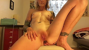 Hot tattooed milf masturbating with buttplug and pussy